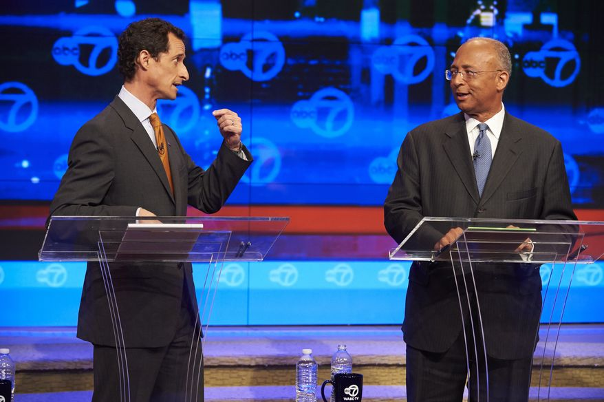New York City Democratic mayoral candidates Anthony Weiner, left, addresses fellow candidate Bill Thompson during the first primary debate for New York City mayor in the WABC/Channel 7 studios, Tuesday, Aug. 13, 2013, in New York. The debate was hosted by The League of Women Voters of the City of New York, The New York Daily News, plus television stations Univision 41, Noticias, and WABC channel 7. (AP Photo/New York Daily News, James Keivom, Pool)