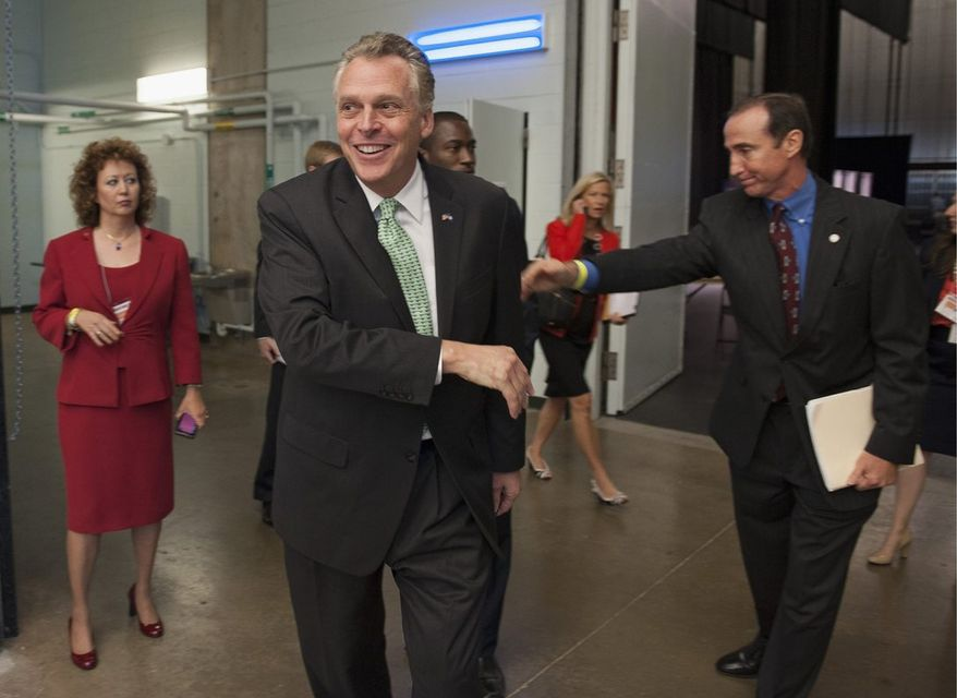 Terry McAuliffe, a prolific Clinton fundraiser who is outpacing Republican rival Kenneth T. Cuccinelli II, has shifted millions of his campaign dollars to the Virginia Democratic Party, where it can be spent on attack ads and get-out-the-vote efforts. (Associated Press)