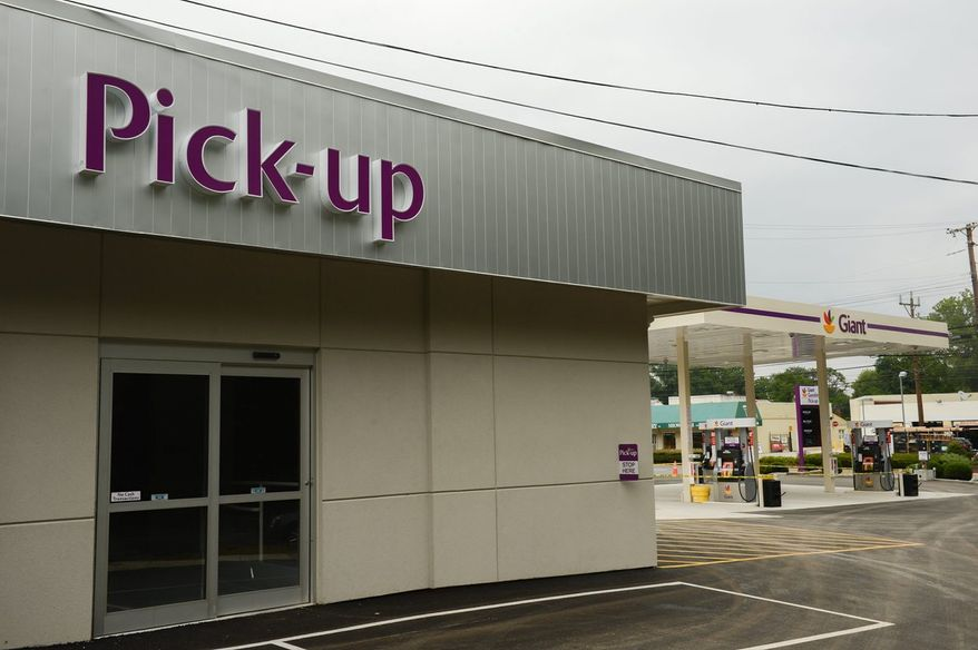 Peapod, the grocery delivery service of Giant Food, has opened its first standalone pick-up location for online orders at a gas station also run by Giant on Connecticut Avenue in Chevy Chase. Attendants load boxes into the customers' trunks. (Andrew Harnik/The Washington Times)