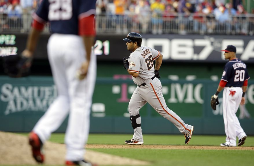 San Francisco Giants' Hector Sanchez (29) rounds the bases for his three-run homer during the ninth inning of a baseball game against the Washington Nationals at Nationals Park, Thursday, Aug. 15, 2013, in Washington. The Giants won 4-3. (AP Photo/Alex Brandon)