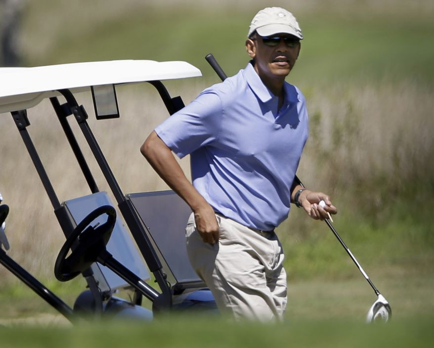 **FILE** President Obama walks toward the tee while golfing at Vineyard Golf Club in Edgartown, Mass., on the island of Martha's Vineyard on Wednesday, Aug. 14, 2013. (Associated Press)