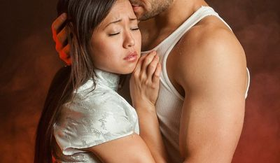 """""""The role of Kim was the hardest to cast because of the vocal demands and my determination to have all the Asian roles played by Asians,"""" says director Eric Schaeffer of casting Diana Huey as Kim, a Vietnamese bar girl, in Signature Theatre's """"Miss Saigon."""" She stars with Jason Michael Evans as Chris, an American soldier."""