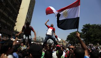 ** FILE ** Supporters of Egypt's ousted President Mohammed Morsi chant slogans during a protest in Ramses Square in downtown Cairo on Friday, Aug. 16, 2013. (Associated Press)