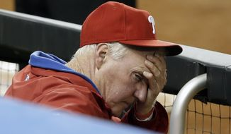 FILE - In this May 20, 2013 file photo, Philadelphia Phillies manager Charlie Manuel rubs his forehead in the ninth inning during a baseball game against the Miami Marlins in Miami. Manuel was fired as manager of the Philadelphia Phillies on Friday, with his team way out of the pennant race and in a tailspin since the All-Star break. (AP Photo/Lynne Sladky, File)