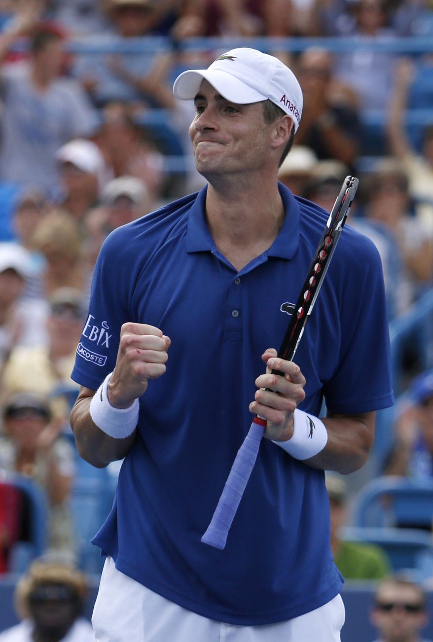 John Isner, from the United States, reacts after defeating Juan Martin del Potro, from Argentina, during a semifinal at the Western & Southern Open tennis tournament, Saturday, Aug. 17, 2013, in Mason, Ohio. Isner won 6-7 (5), 7-6 (9), 6-3. (AP Photo/David Kohl)