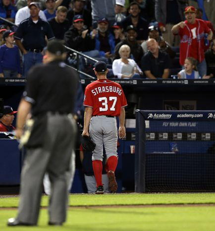 Stephen Strasburg heads off the field after being ejected by home plate umpire Marvin Hudson in the second inning of the Nationals' game against the Braves. (Associated Press photo)