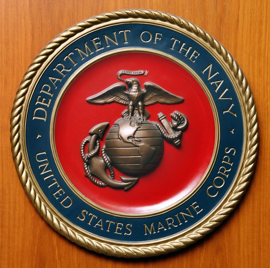**FILE** Logo of the United States Marine Corps pictured at the embassy of the USA in Berlin, Germany, Friday, Aug. 10, 2007. (AP Photo/Michael Sohn)