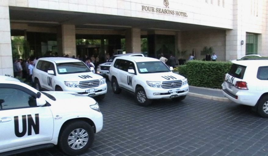 In this image made from video, U.N. vehicles leave the entry area of a hotel after U.N. weapon inspectors get off their vehicles upon their arrival in Damascus, Syria, on Aug. 18, 2013. A team of U.N. weapons inspectors arrived in Damascus on Sunday for a long-delayed mission to investigate the alleged use of chemical arms in Syria's civil war. (Associated Press)