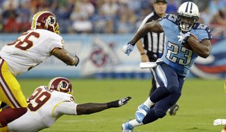 Tennessee Titans running back Shonn Greene (23) evades Washington Redskins defenders Perry Riley (56) and Jarvis Jenkins (99) in the first quarter of a preseason NFL football game on Thursday, Aug. 8, 2013, in Nashville, Tenn. (AP Photo/Wade Payne)