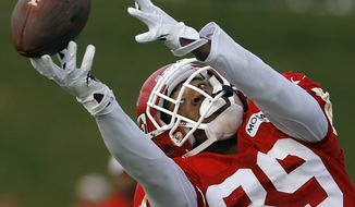 Kansas City Chiefs wide receiver Jon Baldwin (89) dives to catch the ball during NFL football training camp in St. Joseph, Mo., Tuesday, Aug. 13, 2013. (AP Photo/Orlin Wagner)