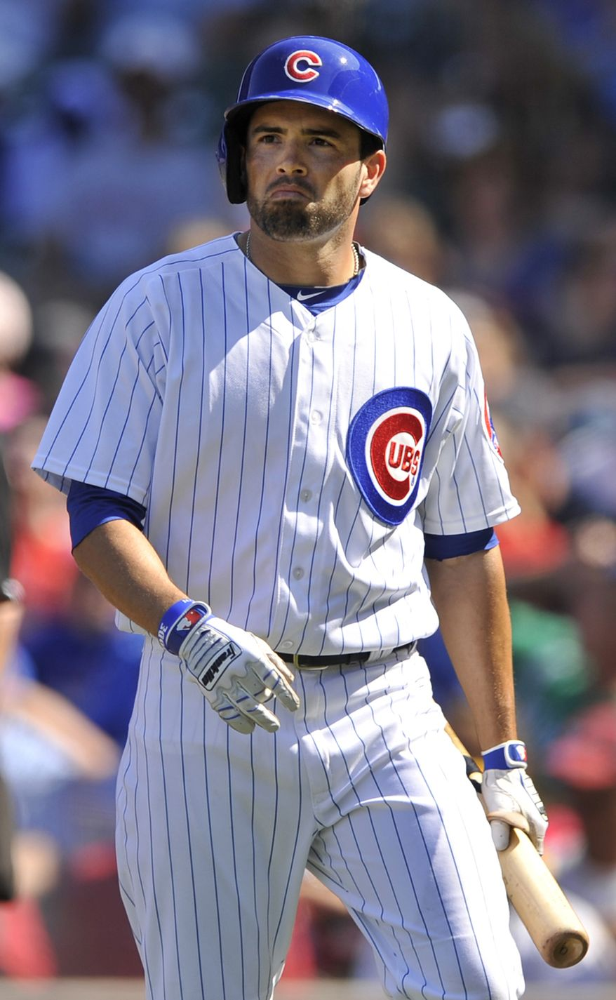Chicago Cubs' David DeJesus reacts after striking out during the first inning of a baseball game against the St. Louis Cardinals in Chicago, Saturday, Aug. 17, 2013. (AP Photo/Paul Beaty)