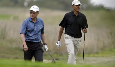 President Obama (right) and World Bank President Jim Kim play golf at Vineyard Golf Club in Edgartown, Mass., on Martha's Vineyard on Sunday, Aug. 18, 2013. (AP Photo/Steven Senne)