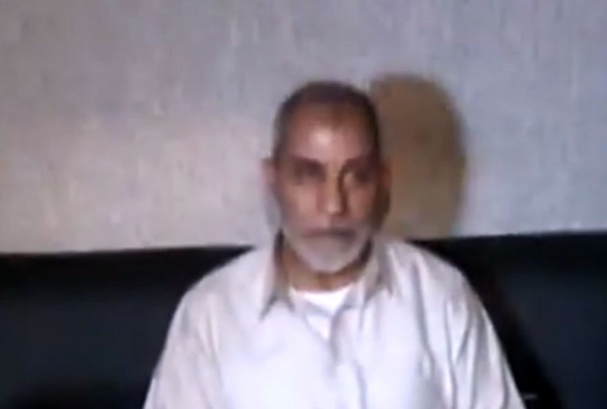 Mohammed Badie, the supreme leader of the Muslim Brotherhood, is seen in a screen capture from Egypt State TV after being detained by Egyptian security officials in Cairo on Tuesday, Aug. 20, 2013. (AP Photo/Egypt State TV)