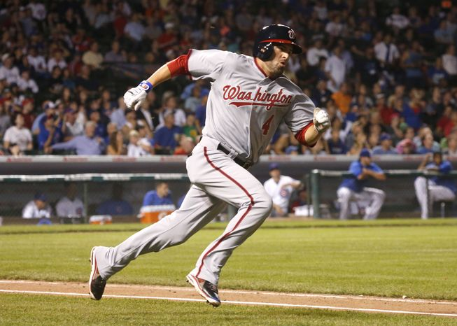 New Washington Nationals outfielder David DeJesus runs out a pop up in his first at-bat with the team. DeJesus, who was traded from the Chicago Cubs, got a standing ovation from the Cubs fans in his first at-bat with the Nationals. (Associated Press photo)