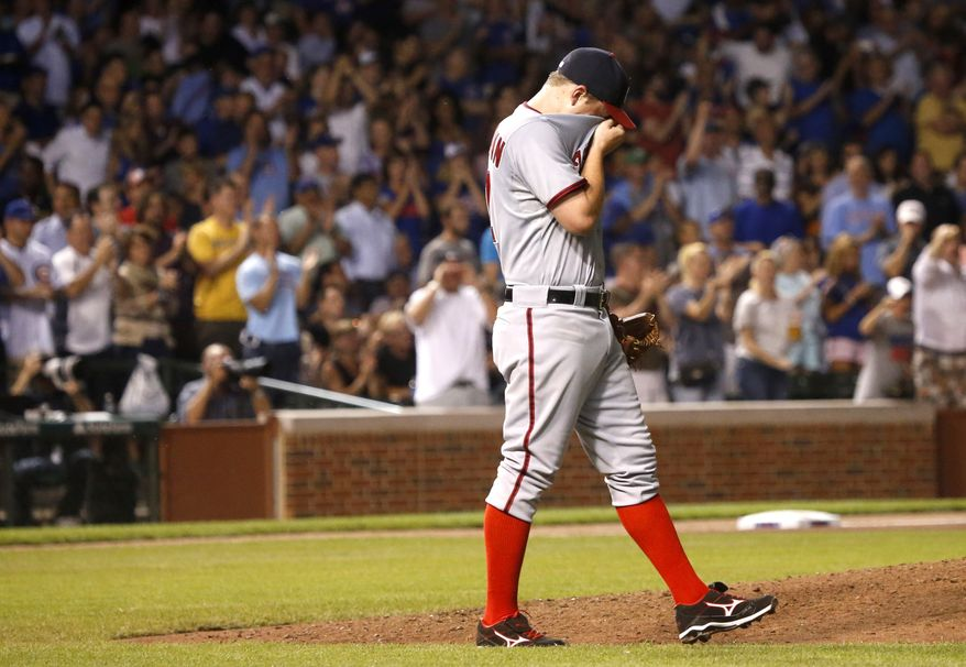 Washington Nationals right-hander Jordan Zimmermann reacts after giving up a three-run homer to Chicago Cubs catcher Dioner Navarro in the fifth inning Monday night. The Nationals lost 11-1 to the Cubs. (Associated Press photo)