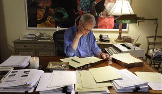 In this 2010 photo, author Elmore Leonard works on a manuscript at his home in Bloomfield Township, Mich. Leonard, one of America's foremost crime writers, has died. He was 87. (AP Photo/Carlos Osorio)