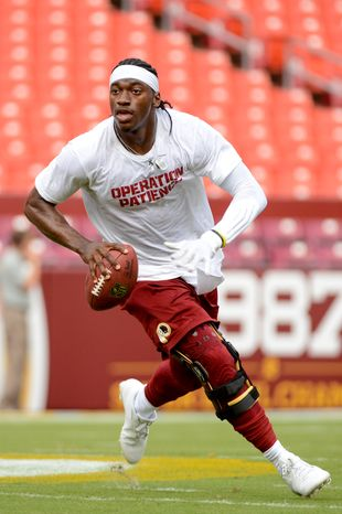Washington Redskins quarterback Robert Griffin III (10) runs during warm ups before the Washington Redskins play the Pittsburgh Steelers in NFL preseason football at FedEx Field, Landover, Md., Monday, August 19, 2013. (Andrew Harnik/The Washington Times)