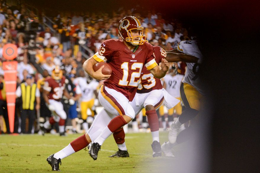 Washington Redskins quarterback Kirk Cousins (12) runs with the ball in the second quarter as the Washington Redskins play the Pittsburgh Steelers in NFL preseason football at FedEx Field, Landover, Md., Monday, August 19, 2013. (Andrew Harnik/The Washington Times)