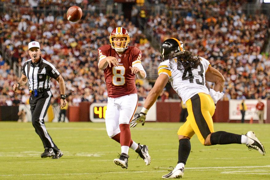 Washington Redskins quarterback Rex Grossman (8) throws while being chased by Pittsburgh Steelers strong safety Troy Polamalu (43) in the second quarter as the Washington Redskins play the Pittsburgh Steelers in NFL preseason football at FedEx Field, Landover, Md., Monday, August 19, 2013. (Andrew Harnik/The Washington Times)
