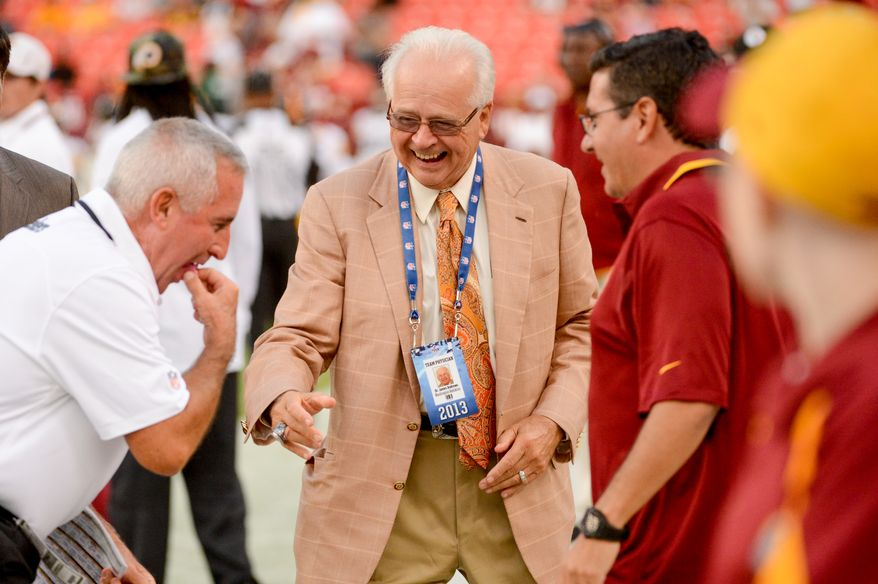 Former Washington Redskins Special Teams Coach Danny Smith, left, Dr. James Andrews, center, and Washington Redskins owner Dan Snyder, right, joke together before the Washington Redskins play the Pittsburgh Steelers in NFL preseason football at FedEx Field, Landover, Md., Monday, August 19, 2013. (Andrew Harnik/The Washington Times)