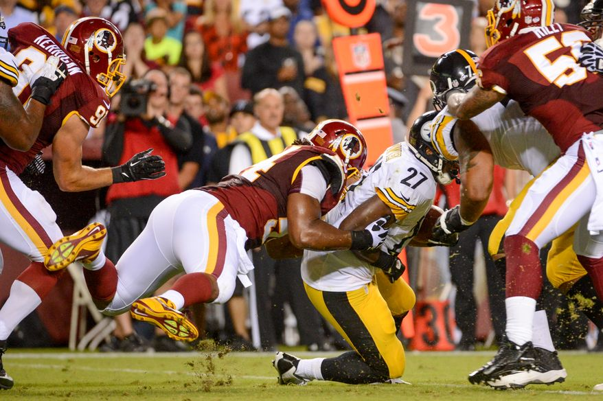 Washington Redskins linebacker Darryl Tapp (54) tackles Pittsburgh Steelers running back Jonathan Dwyer (27) as the Washington Redskins play the Pittsburgh Steelers in NFL preseason football at FedEx Field, Landover, Md., Monday, August 19, 2013. (Andrew Harnik/The Washington Times)
