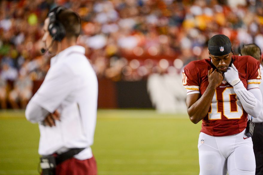 Washington Redskins offensive coordinator Kyle Shanahan, left, and Washington Redskins quarterback Robert Griffin III (10), right, on the sideline as the Washington Redskins play the Pittsburgh Steelers in NFL preseason football at FedEx Field, Landover, Md., Monday, August 19, 2013. (Andrew Harnik/The Washington Times)