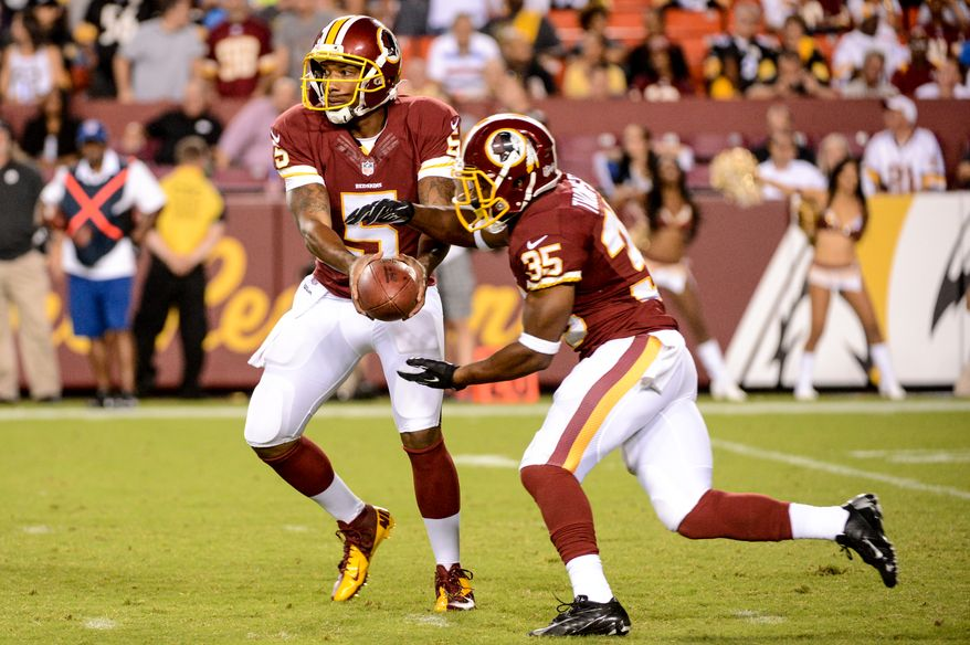 Washington Redskins quarterback Pat White (5) hands off to Washington Redskins running back Chris Thompson (35) as the Washington Redskins play the Pittsburgh Steelers in NFL preseason football at FedEx Field, Landover, Md., Monday, August 19, 2013. (Andrew Harnik/The Washington Times)