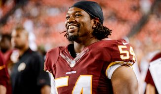 Washington Redskins linebacker Darryl Tapp (54) laughs on the sideline as the Washington Redskins play the Pittsburgh Steelers in NFL preseason football at FedEx Field, Landover, Md., Monday, August 19, 2013. (Andrew Harnik/The Washington Times)