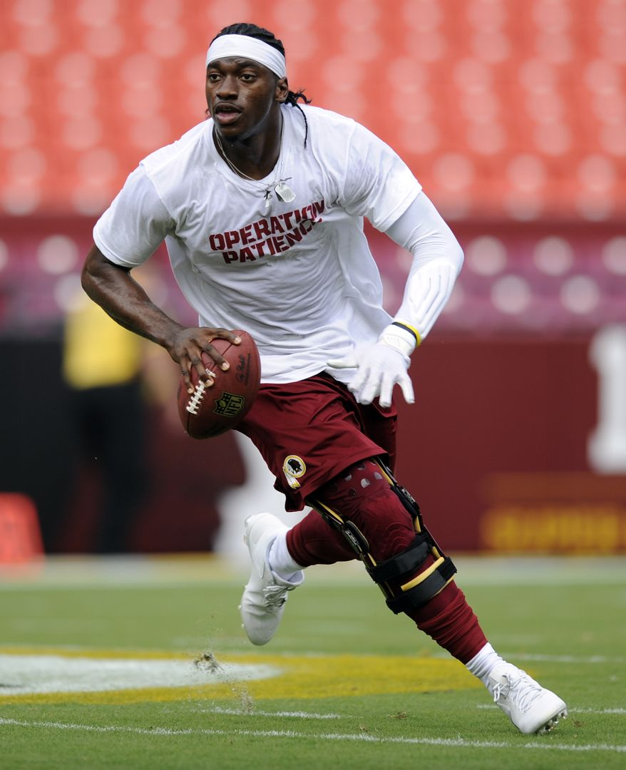 Washington Redskins quarterback Robert Griffin III runs on the field during warm ups before an NFL football game against the Pittsburgh Steelers Monday, Aug. 19, 2013, in Landover, Md. (AP Photo/Nick Wass)