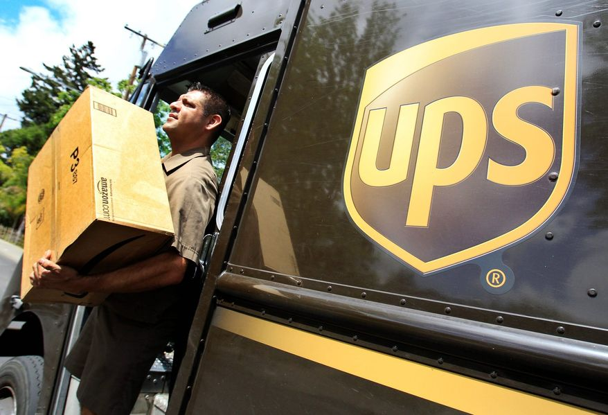 United Parcel Service driver Albert Palafox makes a delivery in Palo Alto, Calif. (ASSOCIATED PRESS)