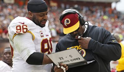 **FILE** Washington Redskins nose tackle Barry Cofield (96) talks with defensive line coach Jacob Burney on the sidelines in the second quarter of an NFL football game against the Cleveland Browns in Cleveland, Sunday, Dec. 16, 2012. (AP Photo/Rick Osentoski)