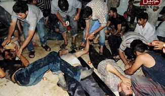 Syrian civilians receive treatment after an alleged poisonous gas attack fired by regime forces, according to activists in Arbeen, Syria, near Damascus, on Wednesday, Aug. 21, 2013, in this citizen journalism image provided by the Local Committee of Arbeen and authenticated on its contents and other AP reporting. (AP Photo/Local Committee of Arbeen)