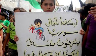 "A citizen journalism image provided by Aleppo Media Center, authenticated based on its contents and other AP reporting, shows a Syrian boy holding an Arabic placard that reads: ""if Syria's children bled petrol, the entire world would have intervened,"" during a demonstration against the alleged chemical weapons attack at the suburbs of Damascus, in Aleppo on Aug. 21, 2013. Syrian anti-government activists accused the regime of carrying out a toxic gas attack that killed at least 100 people, including many children as they slept, during intense artillery and rocket barrages on the eastern suburbs of Damascus, part of a fierce government offensive in the area. (Associated Press/Aleppo Media Center)"