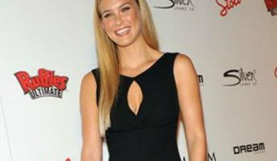 ** FILE ** Bar Refaeli, number one on the Maxim Hot 100 list, arrives to The MAXIM Hot 100 Party presented by Ruffles Ultimate Potato Chips and Dips, May 24, 2012, in New York. (Diane Bondareff/AP Images for Ruffles Ultimate)