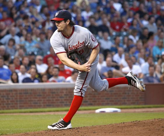 Washington Nationals right-hander Dan Haren delivers a pitch in the Nationals' 4-2 victory over the Chicago Cubs on Tuesday night at Wrigley Field. (Associated Press photo)