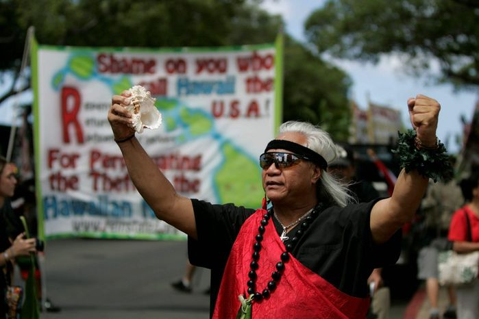 Native Hawaiian activists march during an independence protest in Honolulu as the island commemorates the 50th anniversary of statehood in 2009. The Akaka bill to treat Native Hawaiians the same as other indigenous groups in the U.S. was first introduced in 2000. Approved by the House three times, the measure never passed the Senate. (Associated Press photographs)
