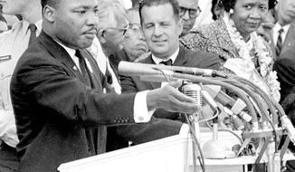 """FILE -  In this Aug. 28, 1963 file photo, Dorothy Height, right, National President of the National Council of Negro Women and Director of the center for Racial Justice of the national YWCA, listens as the Rev. Dr. Martin Luther King Jr., gestures during his """"I Have a Dream"""" speech as he addresses thousands of civil rights supporters gathered in front of the Lincoln Memorial for the March on Washington for Jobs and Freedom in Washington, D.C. Height, who as longtime president of the National Council of Negro Women was the leading female voice of the 1960s civil rights movement, died Tuesday, April 20, 2010. She was 98. (AP Photo, File)"""