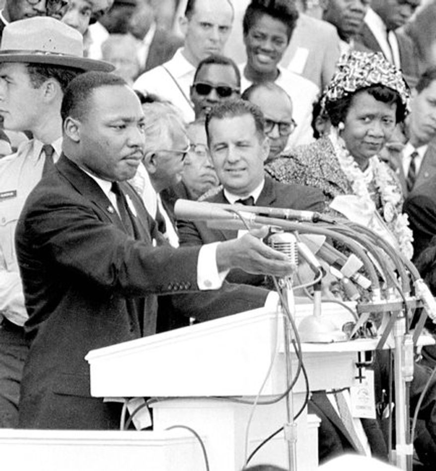 "FILE -  In this Aug. 28, 1963 file photo, Dorothy Height, right, National President of the National Council of Negro Women and Director of the center for Racial Justice of the national YWCA, listens as the Rev. Dr. Martin Luther King Jr., gestures during his ""I Have a Dream"" speech as he addresses thousands of civil rights supporters gathered in front of the Lincoln Memorial for the March on Washington for Jobs and Freedom in Washington, D.C. Height, who as longtime president of the National Council of Negro Women was the leading female voice of the 1960s civil rights movement, died Tuesday, April 20, 2010. She was 98. (AP Photo, File)"