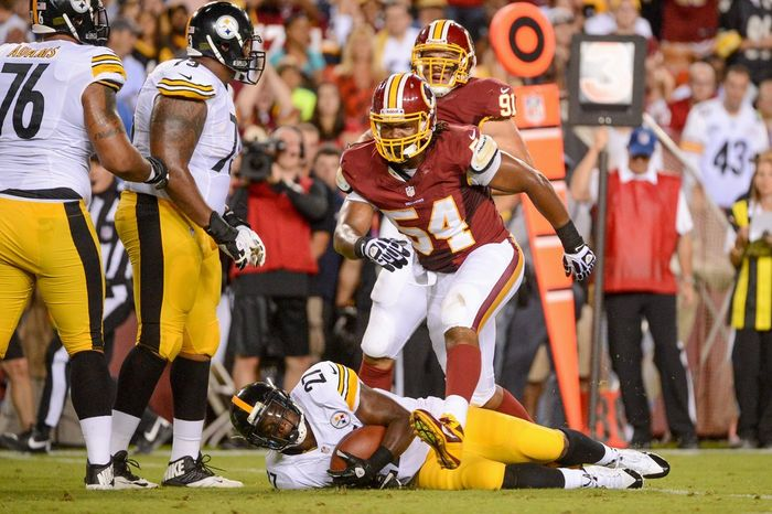 Redskins linebacker Darryl Tapp steps over Steeelers running back Jonathan Dwyer after making a tackle during Monday night's preseason game. (andrew harnik/the washington times)