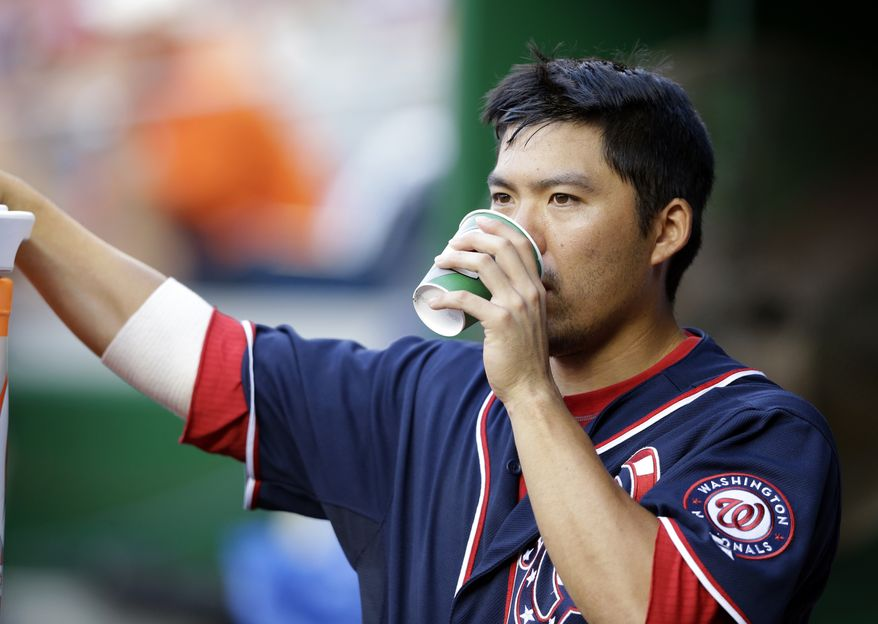 Washington Nationals catcher Kurt Suzuki (24) drinks from a cup in the dugout during a baseball game against the San Francisco Giants at Nationals Park Thursday, Aug. 15, 2013, in Washington. The Giants won 4-3. (AP Photo/Alex Brandon)