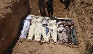 "This image provided by Shaam News Network on Aug. 22, 2013, which has been authenticated based on its contents and other AP reporting, purports to show several bodies being buried in a suburb of Damascus, Syria, during a funeral on Aug. 21, 2013. Syrian government forces pressed their offensive in eastern Damascus on Thursday, bombing rebel-held suburbs where the opposition said the regime had killed more than 100 people the day before in a chemical weapons attack. The government has denied allegations it used chemical weapons in artillery barrages on the area known as eastern Ghouta on Wednesday as ""absolutely baseless."" (Associated Press/Shaam News Network)"