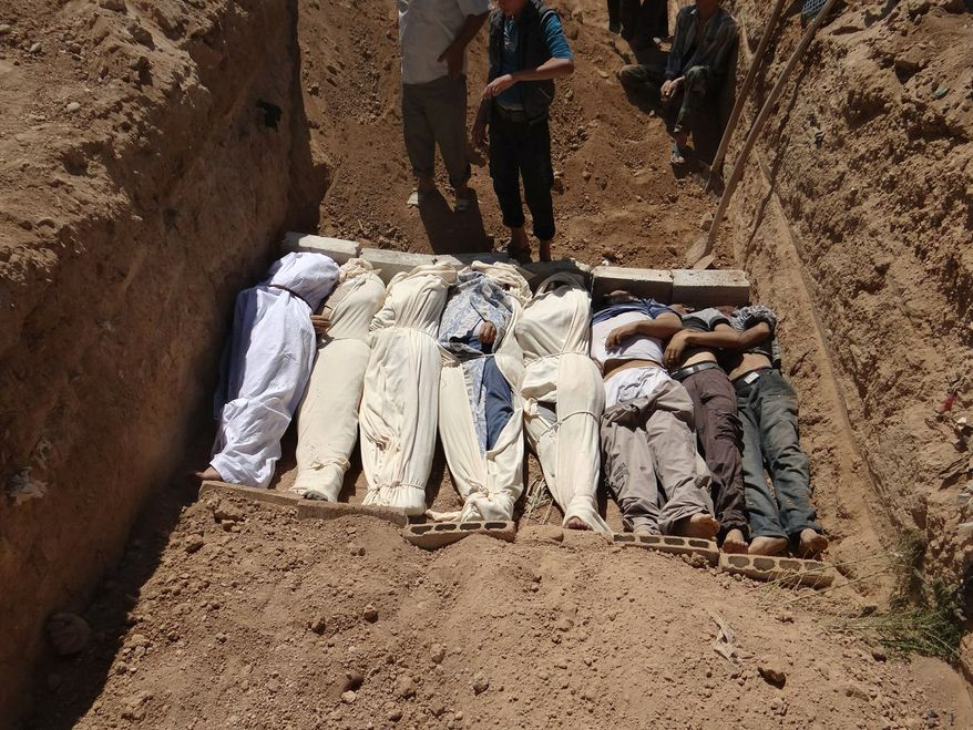"""This image provided by Shaam News Network on Aug. 22, 2013, which has been authenticated based on its contents and other AP reporting, purports to show several bodies being buried in a suburb of Damascus, Syria, during a funeral on Aug. 21, 2013. Syrian government forces pressed their offensive in eastern Damascus on Thursday, bombing rebel-held suburbs where the opposition said the regime had killed more than 100 people the day before in a chemical weapons attack. The government has denied allegations it used chemical weapons in artillery barrages on the area known as eastern Ghouta on Wednesday as """"absolutely baseless."""" (Associated Press/Shaam News Network)"""