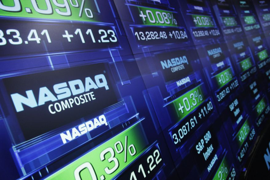 ** FILE ** Stock prices are shown at the Nasdaq MarketSite in New York on Wednesday, Aug. 21, 2012. (AP Photo/Mark Lennihan)