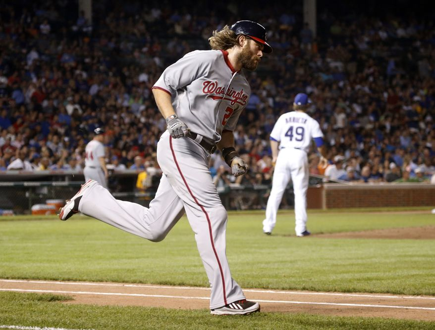 Jayson Werth rounds the bases after the Washington Nationals outfielder crushed a three-run home run on Wednesday night at Wrigley Field. (Associated Press photo)