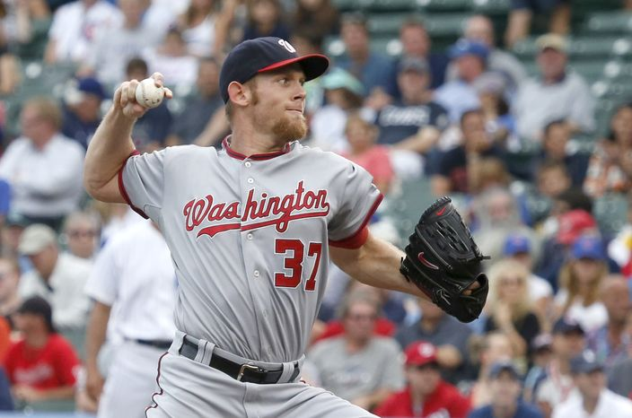 Washington Nationals starting pitcher Stephen Strasburg delivers during the first inning of a baseball game against the Chicago Cubs Thursday, Aug. 22, 2013, in Chicago. (AP Photo/Charles Rex Arbogast)