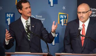 Former Rep. Anthony Weiner (left) gestures while responding to a question as opponent Sal Albanese listens while the Democratic candidates for New York City mayor hold their first debate at the Town Hall on Wednesday, Aug. 21, 2013, in New York. (AP Photo/New York Times, Ruth Fremson, Pool)