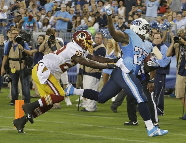 Tennessee Titans running back Shonn Greene (23) scores a touchdown on a 19-yard touchdown run as Washington Redskins defender Bacarri Rambo (29) tries to bring him down in the first quarter of a preseason NFL football game on Thursday, Aug. 8, 2013, in Nashville, Tenn. (AP Photo/Wade Payne)