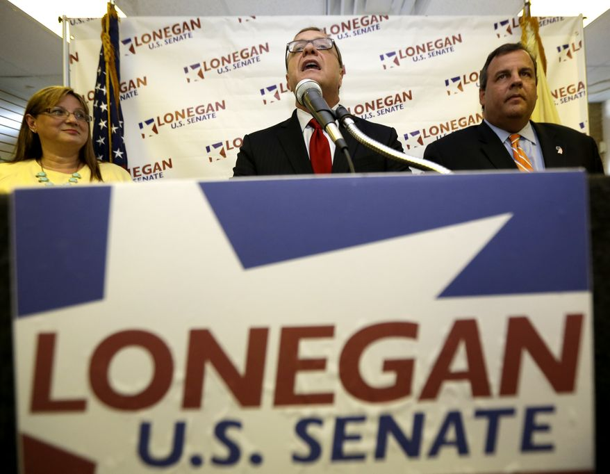 Steve Lonegan (center), a Republican running for the U.S. Senate, talks during a news conference in which New Jersey Gov. Chris Christie (right) announced his endorsement of Mr. Lonegan, on Tuesday, Aug. 20, 2013, in Flemington, N.J. (AP Photo/Julio Cortez)