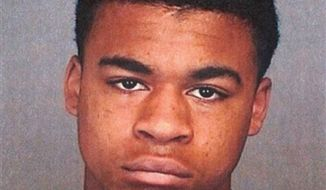 ** FILE ** Kenan Adams-Kinard, 16, was arrested by police in connection with the beating death of an 88-year-old World War II veteran outside an Eagles lodge in Spokane on Wednesday, Aug. 21, 2013. (AP Photo/Spokane Police)