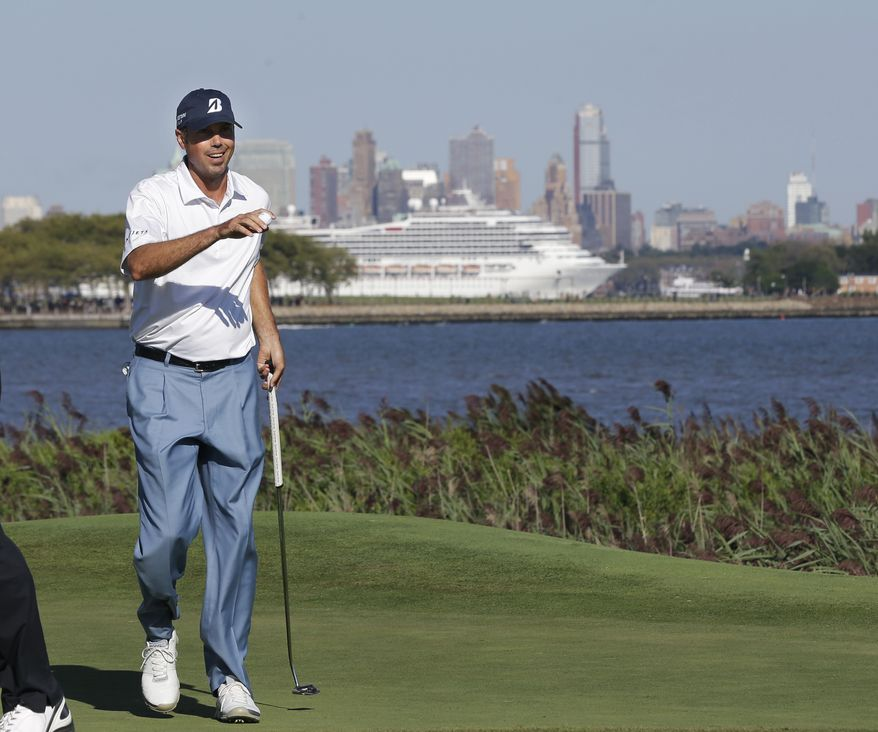Matt Kuchar holds up his ball after making a birdie on 14th hole during the third round of The Barclays golf tournament Saturday, Aug. 24, 2013, in Jersey City, N.J. (AP Photo/Mel Evans)